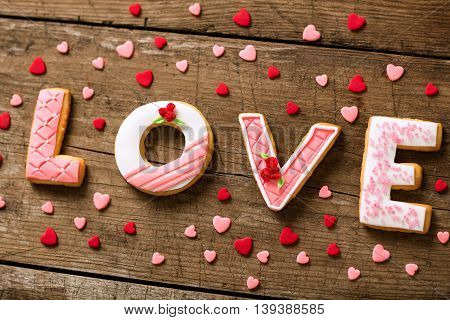 Valentine day cookies on wooden background, holiday concept