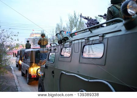 Soldiers on armored vehicles and military trucks on streets of Samara on military celebration, Russia