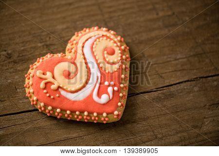 Festive orange valentive cookie decorated, holiday concept