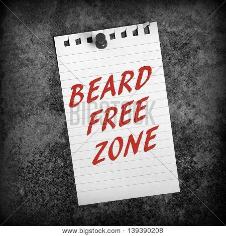The phrase Beard Free Zone in red text on lined paper pinned to a grunge background processed in black and white for effect