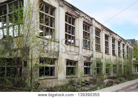 Abandoned big workshop of old factory in Samara, Russia at spring day