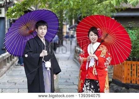 KYOTO,JAPAN- CIRCA MAY,2016:Japanese couple in traditional cloths walking in the Gion district in Kyoto.