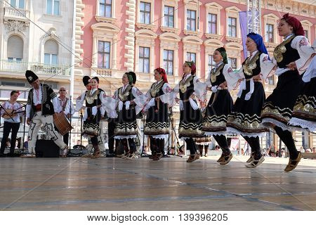 ZAGREB, CROATIA - JULY 21: Members of folk group Bistrica from Bistrica, Bulgaria during the 50th International Folklore Festival in center of Zagreb, Croatia on July 21, 2016