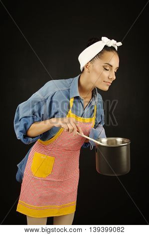 beautiful woman cooking good food meal concept on black background