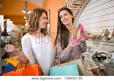 Beautiful, young and happy girls finding the perfect pair