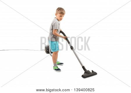 Boy Using Vacuum Cleaner Over White Background