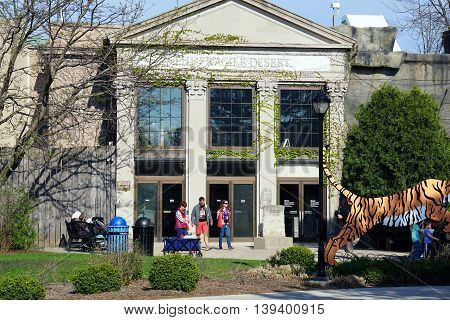 BROOKFIELD, ILLINOIS / UNITED STATES - APRIL 23, 2015: People walk out of the Brookfield Zoo's Fragile Dessert exhibit.