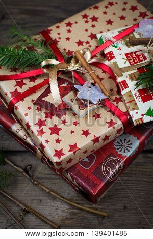 Christmas gifts wrapped in gold and red