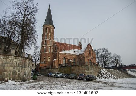 Kaunas, Lithuania - January 3, 2016: Brick Church of the Assumption of The Holy Virgin Mary in the bank of rever Neman
