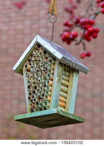 wooden Insect house in an ecological garden