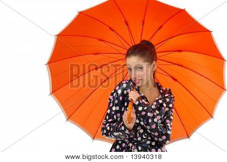 smiling girl with orange umbrella over white