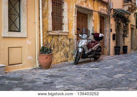 CHANIA, CRETE, AUGUST 2016: Motorcycle at old street of Chania town on Crete island, Greece