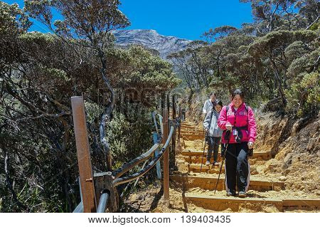 Ranau Sabah Borneo-March 12,2016:Adventurer climber seen at Timpohon trail to Laban Rata of Mountain Kinabalu.Climbing season officially start on Dec 1,2015 after closure due to earthquake on June 2015.
