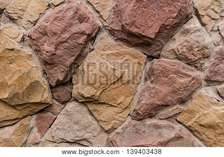 Wall of the old large stones, beige and brown shades