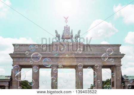 berlin symbol brandenburg gate (Brandenburger Tor) behind soap bubbles