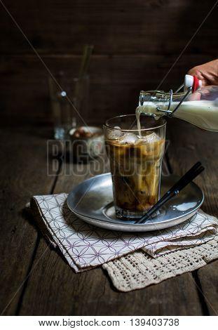 IA glass of iced coffee with hazelnut syrup and milk