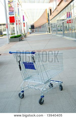 shooping cart outside  closed mall. No people. crisis