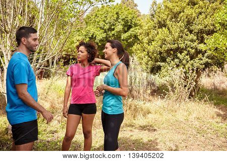 Three Young Joggers Smiling On A Break
