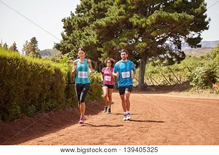 Three Runners On A Race Track