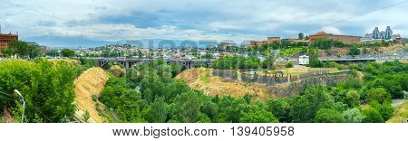Panorama of the Hrazdan gorge in Yerevan with the Victory bridge and cloudy Ararat Mount on the background Armenia.