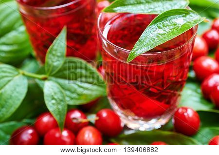Sweet liqueur made from ripe cornelian cherry and alcohol