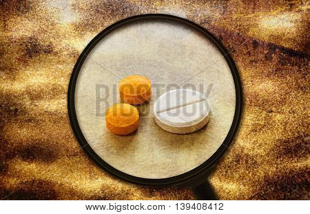 Tablets under a magnifier on grunge background