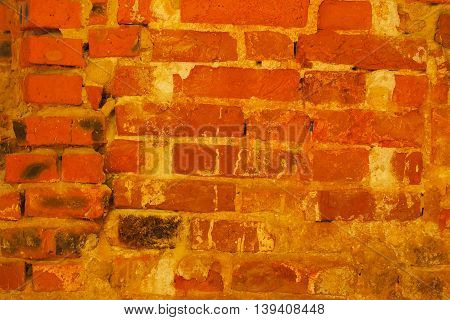 Old damaged wall: seamless texture of red brick wall. Grunge architecture pattern. For background with use vintage effect. With place for your text