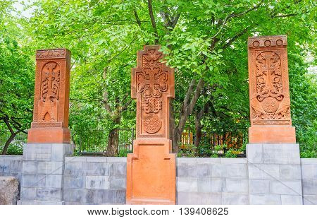 The cross stones named Khachkars with beautiful carved patterns on religious themes St Sarkis Cathedral Yerevan Armenia.