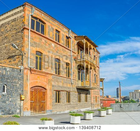 The scenic residential house built of the local stone Yerevan Armenia.