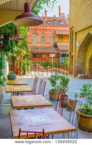 TBILISI GEORGIA - MAY 29 2016: The cozy outdoor cafe in Shavteli street offers the best coffee in city on May 29 in Tbilisi.