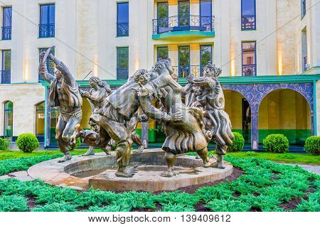 TBILISI GEORGIA - MAY 28 2016: The scenic statue of people dancing in ring named Berikaoba (National Holiday) located in front of Children's Art Gallery on May 28 in Tbilisi.