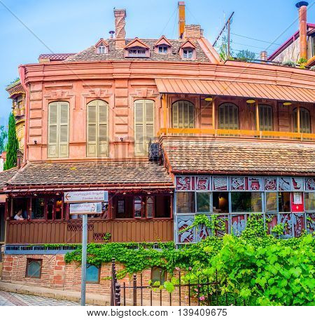 TBILISI GEORGIA - MAY 28 2016: The beautiful art cafe located adjacent to the Rezo Gabriadze Puppet Theatre on May 28 in Tbilisi.