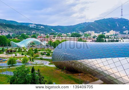 TBILISI GEORGIA - MAY 28 2016: The city appearance start to change with the advent of new glass and metal constructions in center on May 28 in Tbilisi.