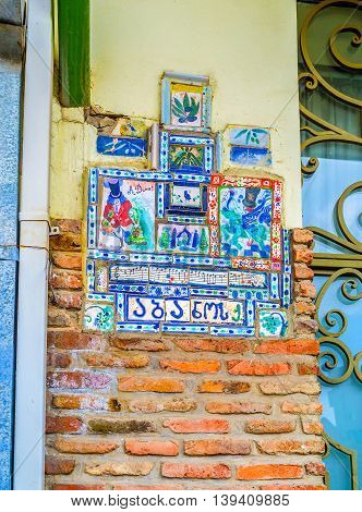 TBILISI GEORGIA - MAY 28 2016: The colorful tiled decoration next to the entrance to the souvenir store on May 28 in Tbilisi.