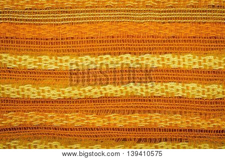 Colorful knitted fabric texture, for abstract background, orange