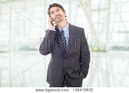 young business man on the phone, at the office