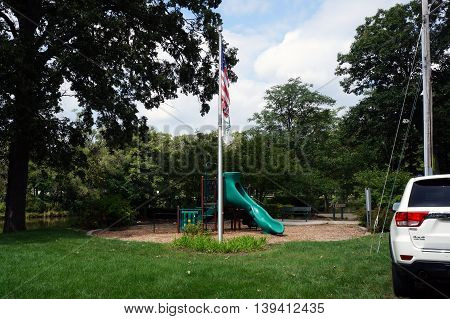 SHOREWOOD, ILLINOIS / UNITED STATES - AUGUST 30, 2015: The Little Coyote Park is a public playground for children along the shore of the Du Page River in Shorewood, Illinois.