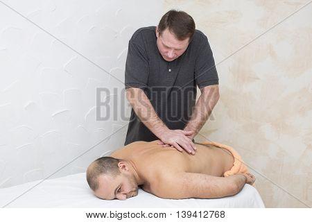 man doing sports massage at the massage parlor
