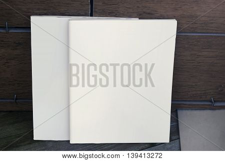 Mock-up magazine and catalog on wood background. Most realistic cover for your design.