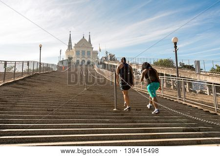 Two women climbing the 382 steps to the Penha Church in Rio de Janeiro