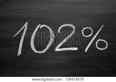 102 percent header written with a chalk on the blackboard