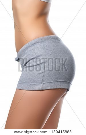 Slim Tanned Woman's Body. Isolated Over White Background