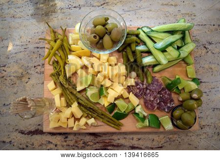 Ingredients arranged beautifully on a wooden platter to be added to a Bloody Mary