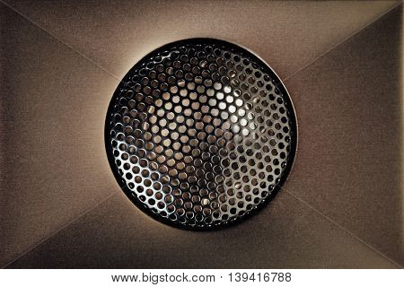 brown audio tweeter with grill mesh