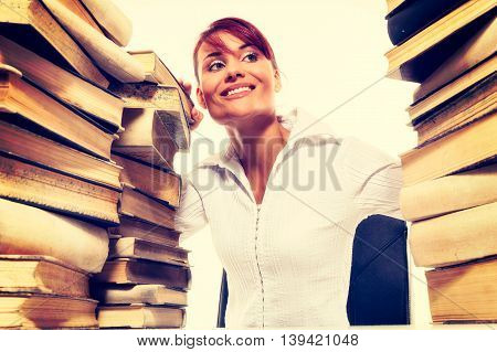 Education Concept. Beautiful Young Woman With Stack Of Books On White Background