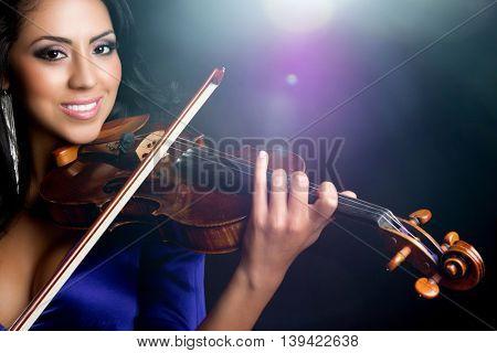 Beautiful smiling latin woman playing violin