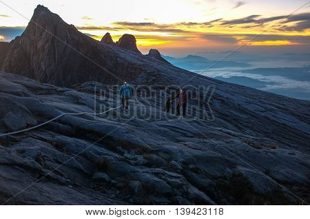 Mount Kinabalu,Ranau,Sabah Borneo-March 12,2016:Group of climber passing trail to the summit Mountain of KinabaluMt Kinabalu (4095m) is the tallest mountain in South-East Asia and is situated in the Kinabalu National Park in the province of Sabah in Malay