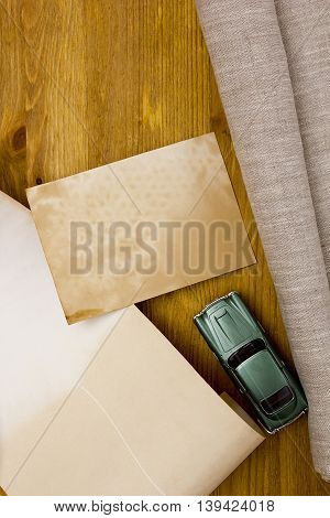 Toy models of cars and a linen cloth on a wooden table