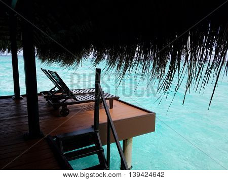 Outdoor relaxing deck of the water bungalow