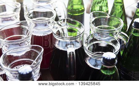 Fresh Colored Juice Glass Bottles on Vintage Wooden Table
